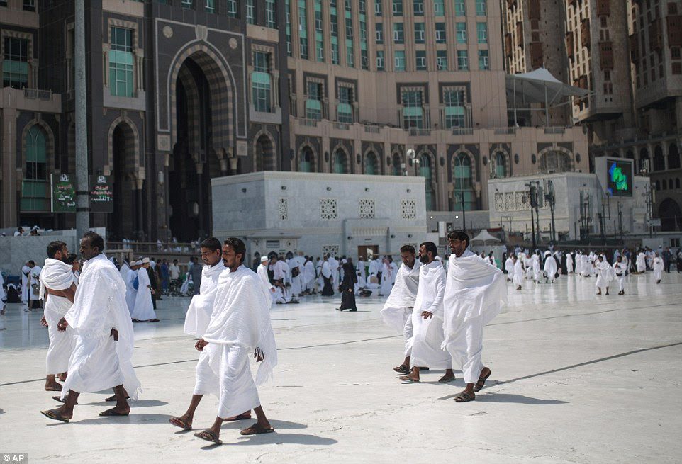 Pictures show pilgrims circling the Kaaba, the black cube-shaped structure in Mecca's Grand Mosque toward which all Muslims pray