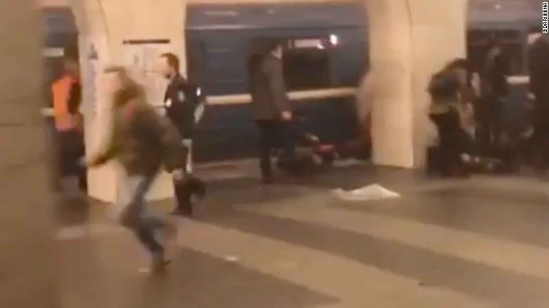 People run after an explosion at a St Petersburg metro station.