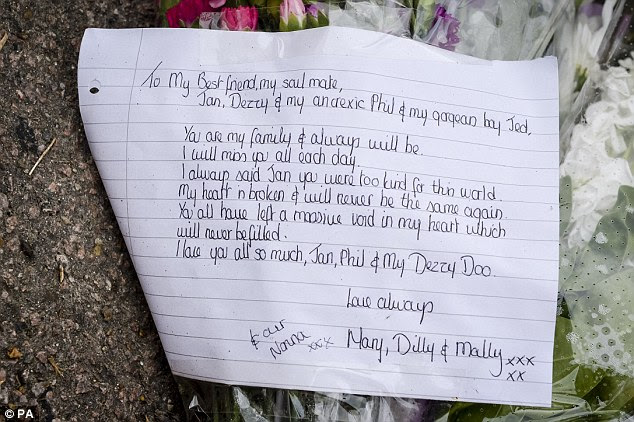 Touching: A handwritten note left near the property where the bodies were discovered last night