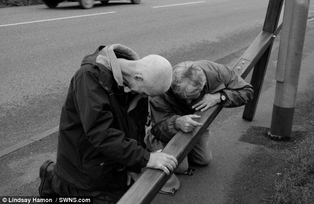 Compassion: He stops to pray with a stranger as he journey's around the world. Mr Hamon as given counselling to many people in need of help during his travels