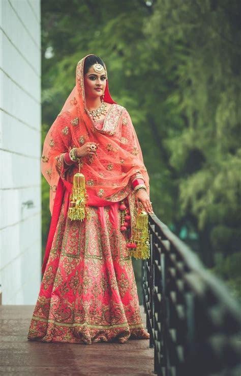 Glorious Coral Pink Bridal Lehenga Designs you?ll Love