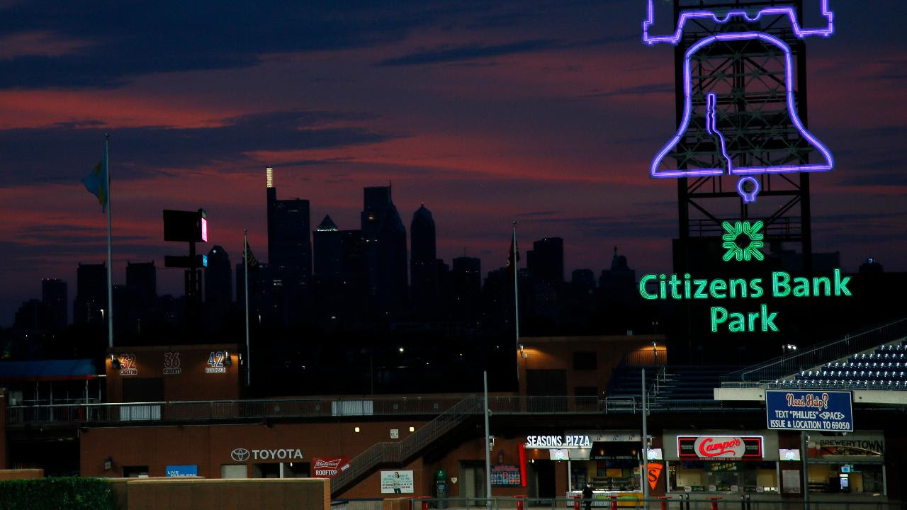 the Philadelphia skyline is viewed during sunset at Citizens Bank Park in Philadelphia. Bird Safe Philly announced on Thursday, March 11, 2021, that Philadelphia is joining the national Lights Out initiative, a voluntary program in which as many external and internal lights in buildings are turned off or dimmed at night during the spring and fall bird migration seasons. Image credit: AP Photo/Matt Slocum