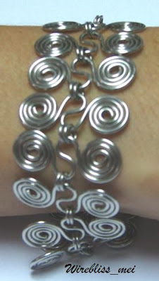 'S' shaped spirals are linked together with two jump rings to from the bracelet