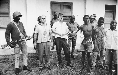 Two British businessmen held prisoner, along with Biafrans, after being beaten by Nigerian federal troops during the civil war between the central government and the province of Biafra (19671970). [HULTON-DEUTSCH COLLECTION/CORBIS]