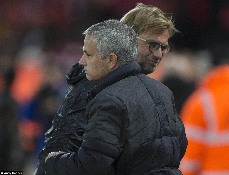 Rival managers Mourinho and Klopp embrace on the touchline prior to kick off to their sides' big Monday night clash