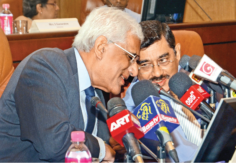 Central Bank Governor Dr. Indrajit Coomaraswamy and Deputy Governor Dr. P. Nandalal Weerasinghe at yesterday's media conference on the recent Monetary Policy Review of the Central Bank. Picture by Wimal Karunathilake