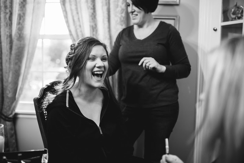 Photos of the bride getting ready at her parents home in Signal Hill, Rockford Illinois before heading to Court Street United Methodist Church for a wedding.
