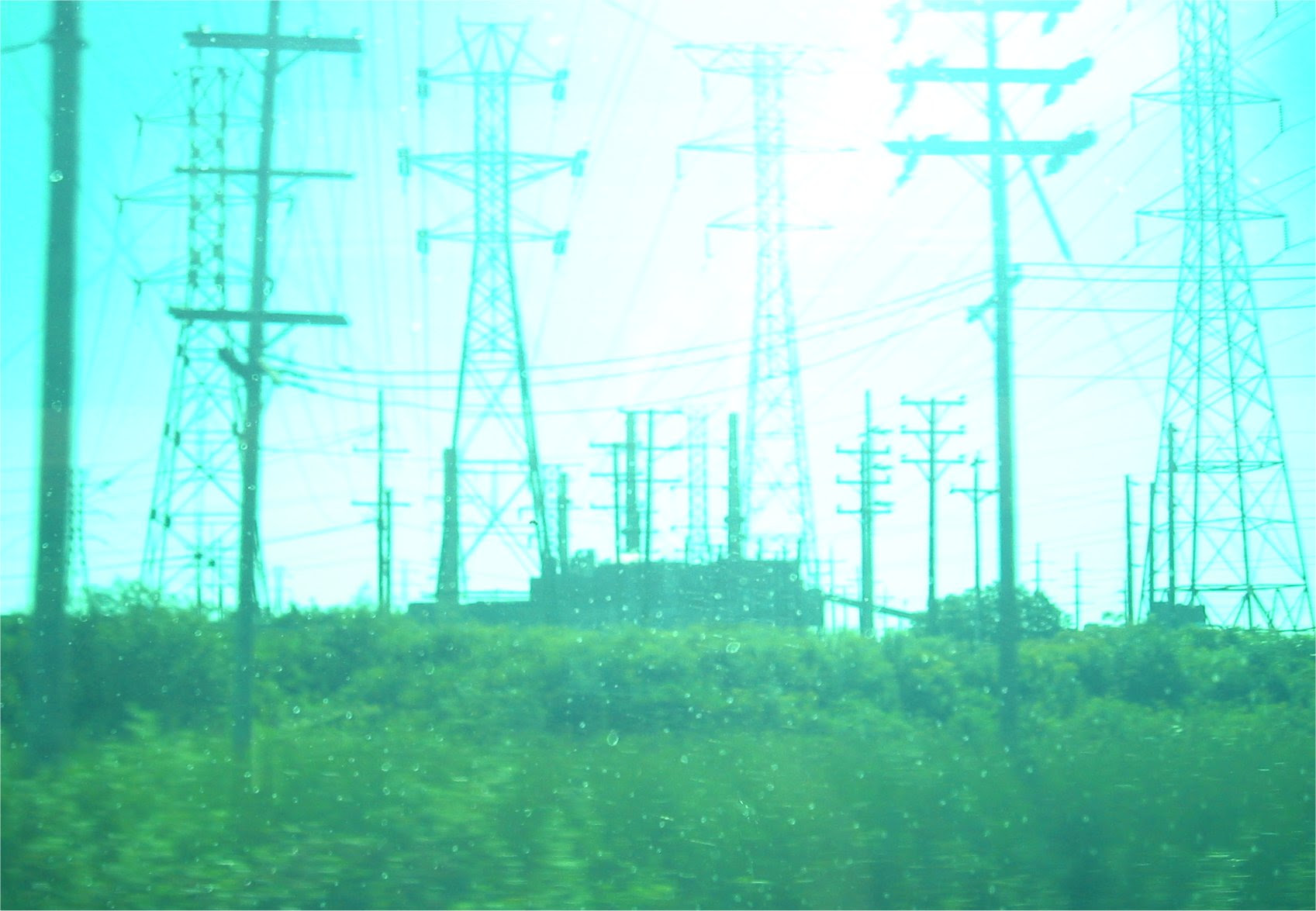 Pleasant Prairie Power plant near Kenosha WI as seem from Metra train - abstract image of high tension electrical wires - soul-amp.com