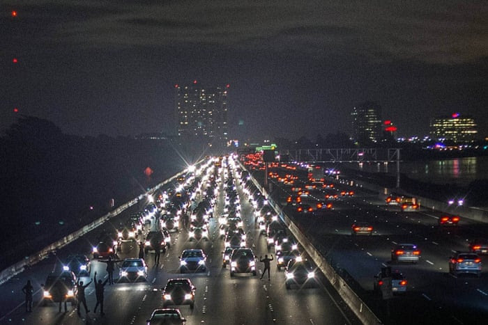 In another photograph by Noah Berger in Berkeley, protesters block interstate 80 in reaction to the grand jury decisions
