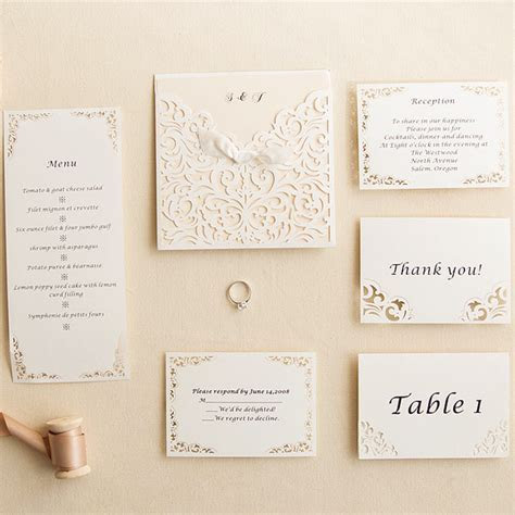 white laser cut pocket ribbon bow invites with matching