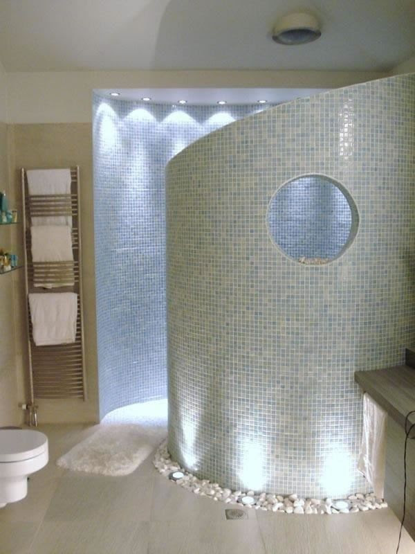 Curved walk in shower- no doors or curtains necessary. Love the porthole too!