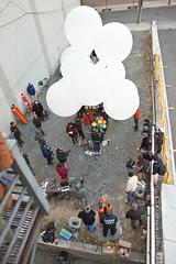 Ken buried among balloons, crew and onlookers.