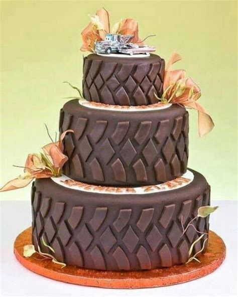 Camo/mudding wedding cake! Love the tow truck Mater on top