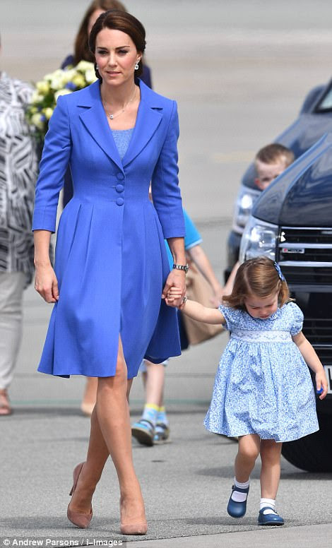 Mother and daughter were sweetly co-ordinated in blue outfits for their journey to Berlin this morning