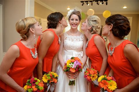 Blood orange dresses and jewelry for the Bridesmaids from