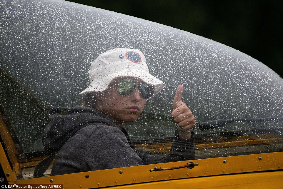 Flight: Civil Air Patrol Cadet, Liz Bell, signals to her wing-runner that she is ready for take-off on a solo flight in a Schweizer SGS 2-33