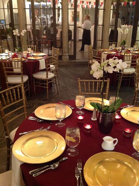 Burgundy linens, gold chargers, gold chivari chairs with