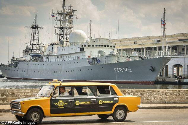Mystery: A Soviet-made Lada limousine passes by the warship. Neither Cuba nor Russia have given any explanation for the presence of the intelligence vessel