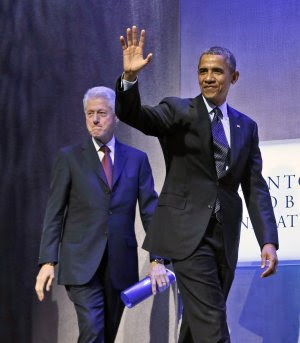 President Barack Obama, right, walks on stage with…