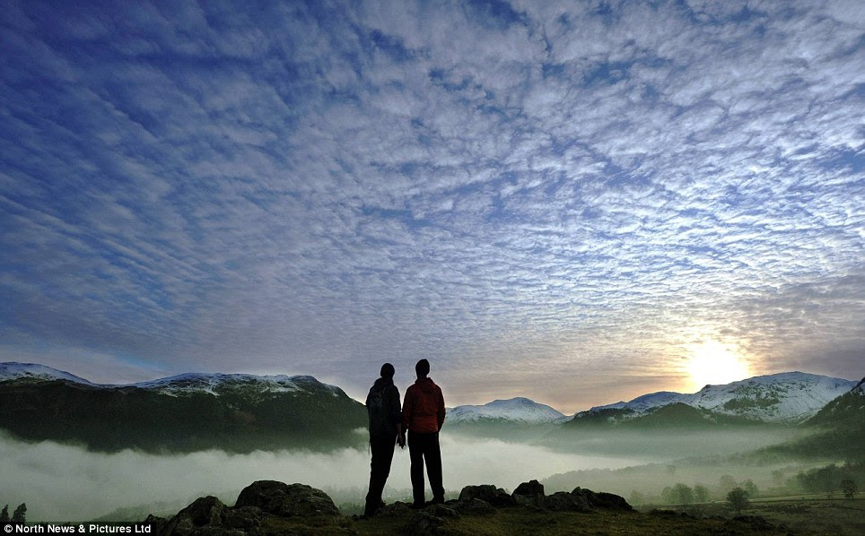Standing in the heavens: As fog descends into the Ullswater valley, in the Lake District, the scene is reminiscent of a frozen glacier, surrounded by snow-capped fells and mountains
