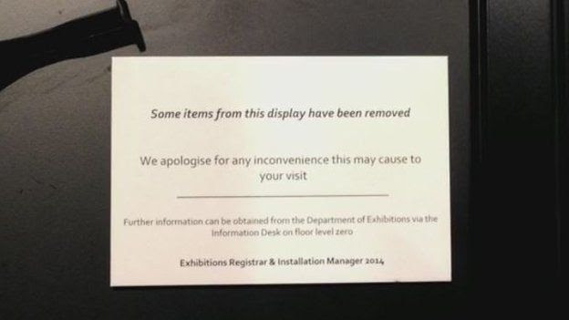 A sign explains that items have been removed from display