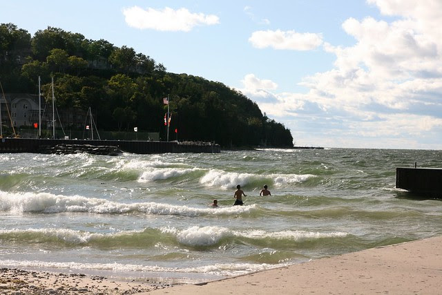 swimmers in the wind storm, sister bay, door county wi
