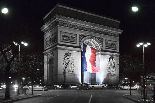Arc De Triomphe By Night With The French Flag My
