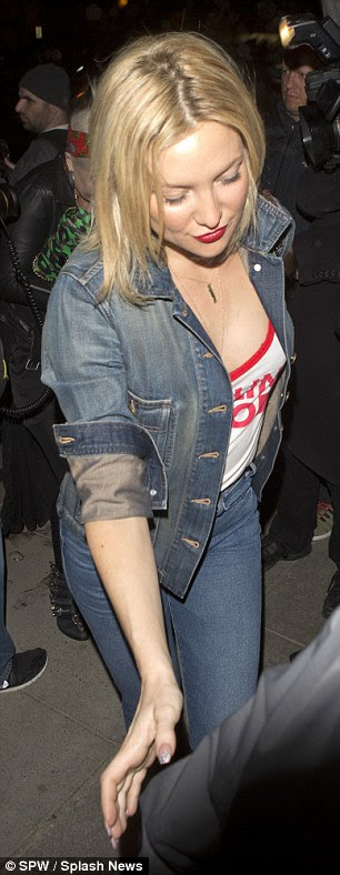 It's in her jeans! She slung an insouciant cropped denim jacket over the trousers