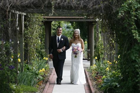 wedding ceremony at Bissell House Rose Garden in North St