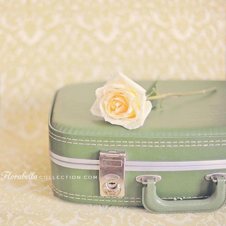 Vintage sage-colored suitcase.