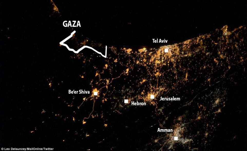 'My saddest photo yet':Tel-Aviv is pictured on the centre of the coastline at the top of the image. The city of Be'er Shiva can be seen towards the centre left, while the Gaza Strip appears as a darker patch running along the coast to the far left. Jerusalem is below Tel-Aviv as the main patch of lights in the centre. Hebron is shown to Jerusalem's left, while the sprawl of lights from Amman are bottom right
