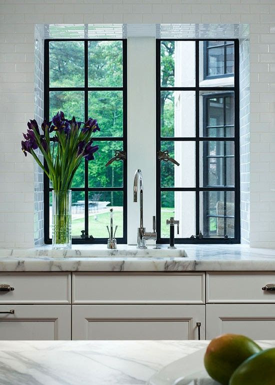black window frames, white brick style tiles, calcutta marble. This will be my kitchen.
