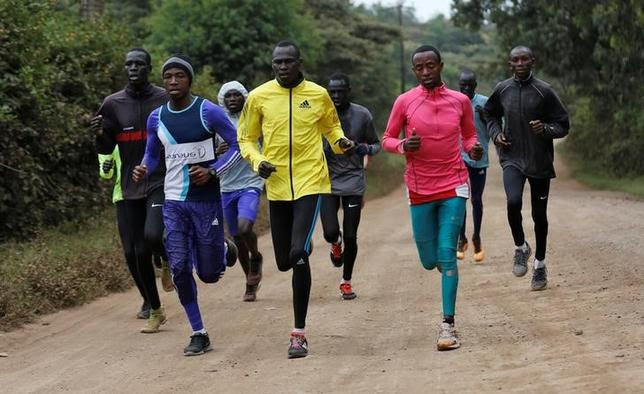 Athletes from South Sudan, part of the refugee athletes who qualified for the 2016 Rio Olympics, and their training partners run along a dusty road during a jogging session at their camp in Ngong township near Kenya's capital Nairobi, June 9, 2016. REUTERS/Thomas Mukoya/Files