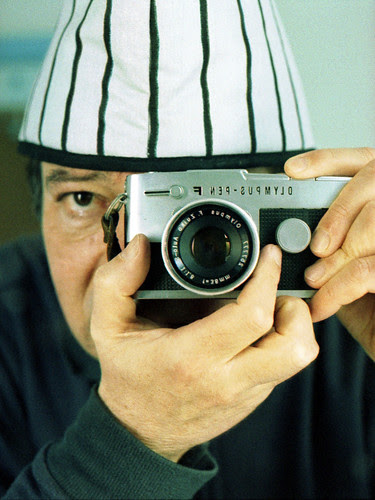 reflected self-portrait with Olympus Pen FT camera and striped hat by pho-Tony