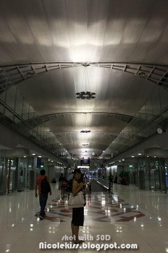 standing in bangkok airport