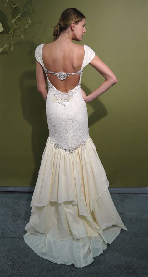 Ivory mermaid Claire Pettibone wedding dress with beading