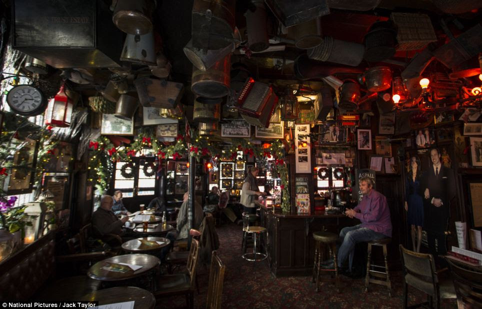 The memorabilia-laden interior of the Churchill arms which has a dazzling outdoor Christmas light display