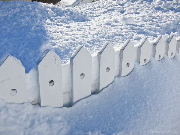 fence buried in snow