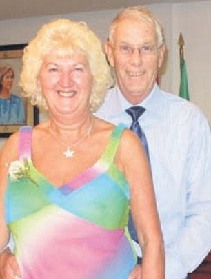Slaughtered: Bruce Wilkinson, pictured with his wife Rita, is understood to have died in the massacre