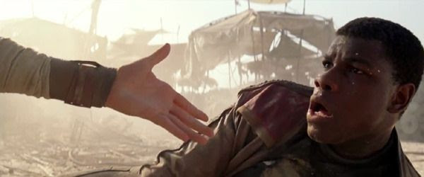 Rey comes to Finn's aid in STAR WARS: THE FORCE AWAKENS.