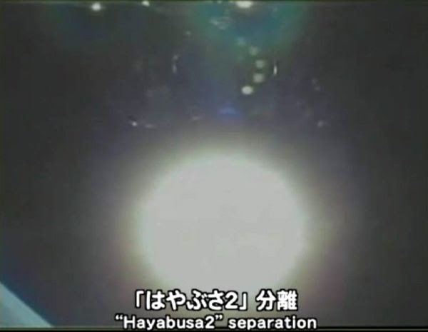 A camera aboard the H-IIA rocket captured this image of Hayabusa 2 shortly after spacecraft separation (the five target markers are visible underneath the robotic probe), on December 3, 2014 (Japan time).
