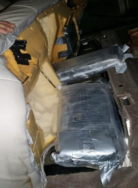 CBP officers at the Port of Nogales discovered more than 65 pounds of marijuana hidden within the seatrs of a smuggling vehicle