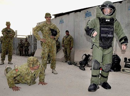 Tony Abbott tries out bomb-disposal gear at Tarin Kowt.