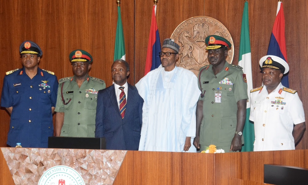 L-R; Chief of Air Staff; Air Marshal Sadique Abubakar; Chief of Defence Staff; General Abayomi Gabriel Olonisakin; Vice President Prof. Yemi Osinbajo; President Muhammadu Buhari; Chief of Army Staff; Lt. General Tukur Yusufu Buratai and Chief of Naval Staff; Vice Marshal Ibok-Ete Ekwe Ibas during the decoration Ceremony of the New Service Chiefs at the Presidential Villa Abuja yesterday