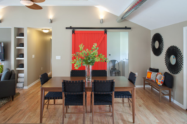 Red barn door with full view of dining table. - transitional