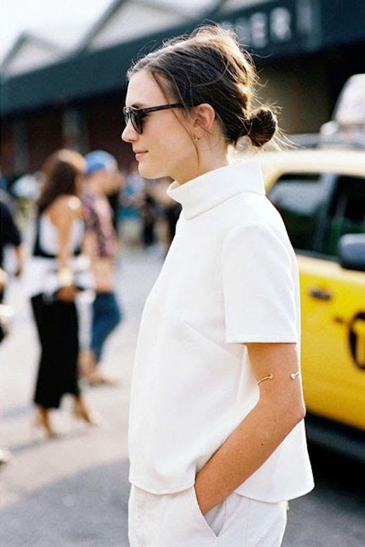 Le Fashion Blog NYC Street Style White On White Low Bun Chignon Mock Neck Top Boyfriend Jeans Via Vanessa Jackman photo Le-Fashion-Blog-NYC-Street-Style-White-On-White-Low-Bun-Chignon-Mock-Neck-Top-Boyfriend-Jeans-Via-Vanessa-Jackman.jpg