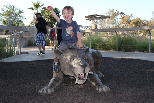 Olsen riding a saber tooth tiger