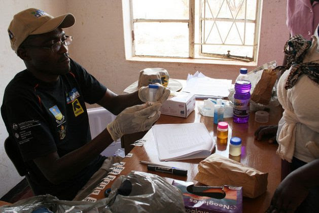 Laboratory Technician Herbert Mtopa collects biological samples at a clinic in Zimbabwe's Shamva District under a CultiAF project to assess exposure of women and children to aflatoxins. Credit: Busani Bafana/IPS