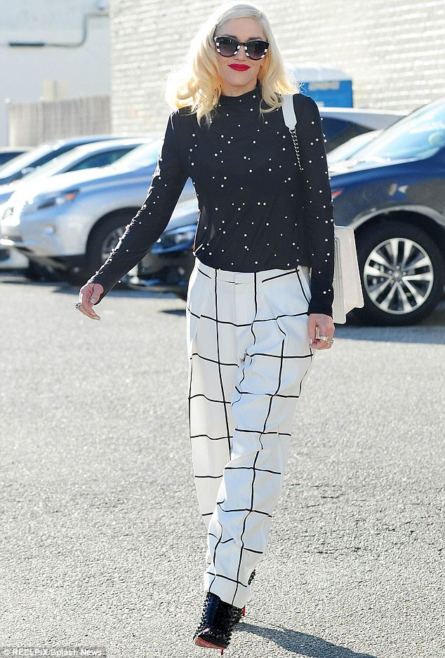 Trendy street style: Gwen Stefani was seen arriving for a lunch date with her husband Gavin Rossdale in Beverly Hills, California on Sunday
