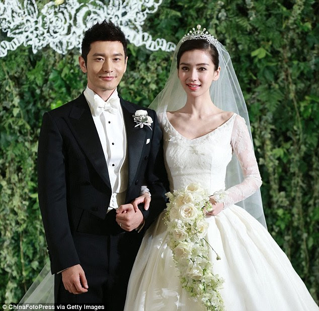 Nuptials: Huang Xiaoming (left) and Anglababy (right) during their wedding ceremony in Shanghai last week
